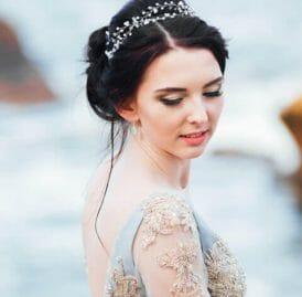 bride-in-a-blue-light-dress-walking-along-the-ocea-3NA4FCW-1.jpg